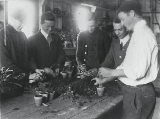 students potting up plants